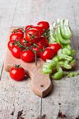 Fresh organic celery and tomatoes — Stockfoto