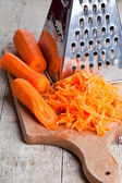 Metal grater and carrot  — Stock Photo