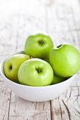 Ripe green apples in bowl  — Stock Photo