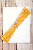 Spaghetti on white paper — Stock Photo