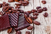 Chocolate sweets and coffee beans — Stock Photo