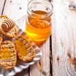 Crackers in plate and honey — Stock Photo #46698905