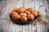 fresh brown eggs in plate — Stock Photo