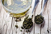 Cup of green tea and spoons — Stock Photo