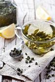 Cup of green tea and lemon — Stock fotografie
