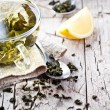Cup of green tea, spoon and lemon  — Stock Photo #47312479
