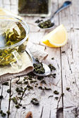 Cup of green tea, spoon and lemon  — Stock Photo