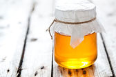 Full honey pot — Stock Photo