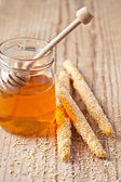 Grissini with sesame seeds and honey — Stock Photo