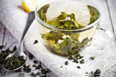 Cup of green tea and lemon — Photo