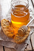 Crackers and honey — Stock Photo