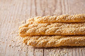 Bread sticks grissini with sesame seeds — Stock Photo