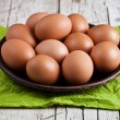 fresh brown eggs in plate and green napkin — Stock Photo #49650967
