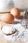 Flour, eggs and kitchen utensil  — Stock Photo