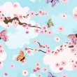 Cherry blossoms background seamless — Stock Vector #14690641