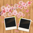 Royalty-Free Stock Vector Image: Photo frame on wooden texture with cherry flowers