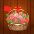 Basket of beautiful tulips with label — Stock Vector