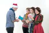 Three girls and the guy on a New Year's holiday — Stock Photo