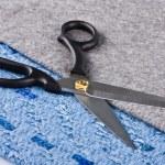 Sharp scissors against a fabric — Stock Photo
