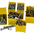 Nails and screws in small yellow boxes — 图库照片