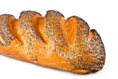 The long loaf covered with a poppy — Stock Photo