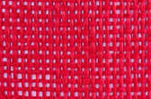 Red background with fabric interlacing — Stock Photo