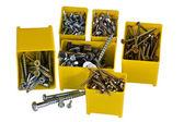 çivi ve vida küçük sarı kutuları — Stok fotoğraf