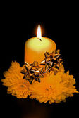 The candle decorated with tapes and flowers — Stockfoto