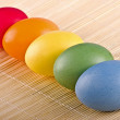 Stock Photo: Multi coloured eggs close up