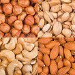 Four kinds of nuts in bulk — Stock Photo