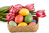Basket with eggs and flowers — Stock Photo