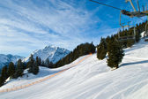 Ski lift in alps mountains, full ski season — Stock Photo
