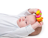 The kid, holds a toy two hands, a thoughtful sight — Stock Photo