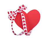 Red hearts with bow on white — Stock Photo