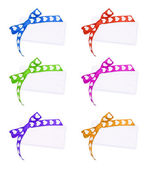 Cards with colors bow on white — Stock Photo