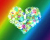 Soyut kalp arka planda gökkuşağı renkleri — Stok fotoğraf