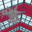 The glass roof decorated with the big snowflakes — Stock Photo