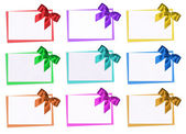 The cards decorated with bows on the white — Stock Photo