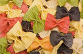 Multi-colored pasta in the form of bows — Stock Photo