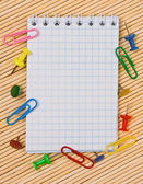 Notebook, paper clips, hairpins, with an empty place for your text — Stock Photo