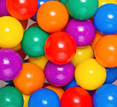 Many colour plastic balls from children's small town — Stock Photo