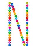 Letter N from plastic children's balls on the white — Stock Photo