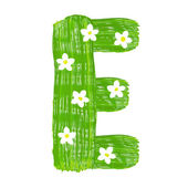 The green letters E drawn by paints with white blossom — Foto Stock