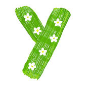 Le lettres vertes y dessiné par les peintures avec fleur blanche — Photo