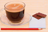 Coffee, red pen and chocolate — Stock Photo