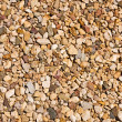 Gravel, stones close up, a background — Stock Photo