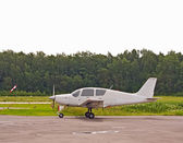 The small plane near to a runway — Stock Photo