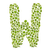 Letter W from green leafs — Stock Photo