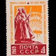 Stock Photo: USSR - CIRC1969: stamp printed in USSR, shows 50 years from date of establishment of Soviet power in Latvia