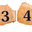 3 and 4 number A on the old paper — Stock Photo